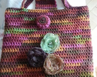 Handmade knitted bag with flowers