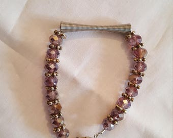 Transparent purple beads and metal bracelet
