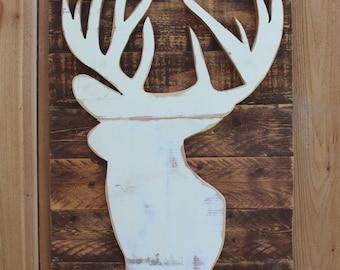 White deer cutout on reclaimed wood