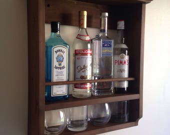 Whisky, rack, Gin, Vodka, spirits wall mounted, waxed,holds four bottles and glasses