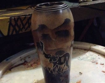 Art work on a ceramic flower vase