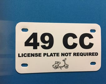 49 cc scooter plate black print on white