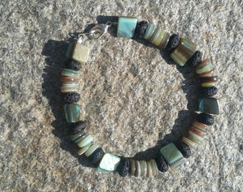 Green shell bead bracelet with lava beads