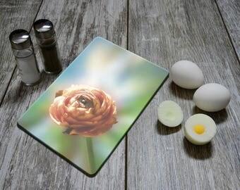 """Glass cutting board """"Ranunculus in the light""""."""