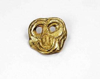 """brooch """"mask"""" in polished gold bronze (Golden)"""