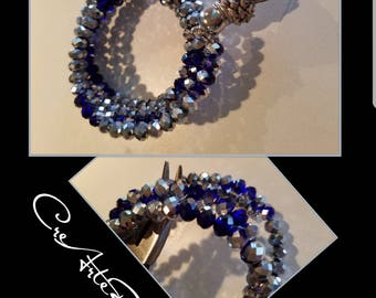 Crystals bracelet electroplated silver and cobalt blue colour with grey tassel.