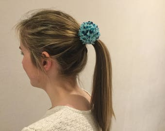 Blue pom-pom hair bobble