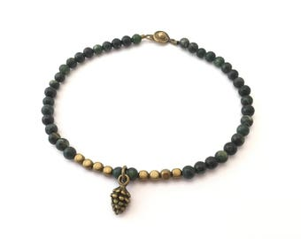SALE - Green serpentine beaded bracelet with brass pine cone charm