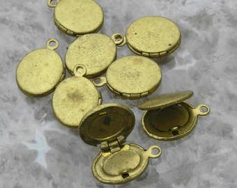 Tiny little vintage brass lockets for adorable charm earrings..