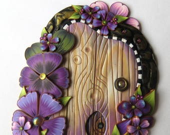 Purple Flower Fairy Door with a Pet Door by Claybykim Polymer Clay Miniature Fairy Gardens and Home