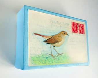 "Original mixed media art. Bird collage and painting on vintage postcard. Small wall art canvas. Nature art. White/blue/red. 6x4""."