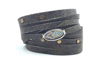 Shi Bandit Cuff: Grey Leather Wrap Cuff with Brass Studs and Silk Charm
