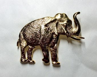 Lucky Elephant with raised trunk gold tone brooch / pin
