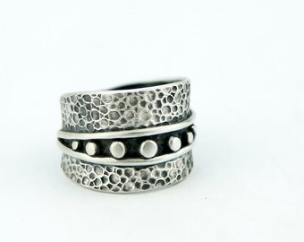 Textured sculpted sterling silver ring with granulation