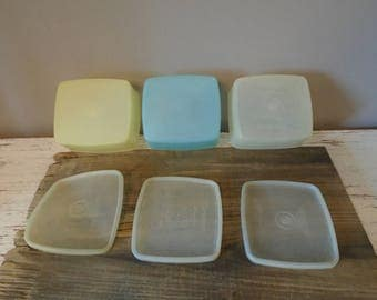 Vintage Tupperware Millionaire line, 1950s Tupperware, three small square storage container with lids in yellow, blue and white