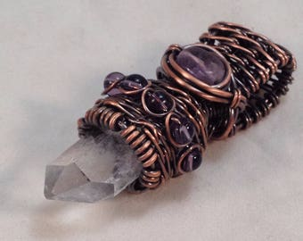 Clear Quartz point with Amethyst in a woven copper cap, pendant