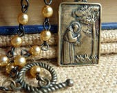 Saint Francis of Assisi* Necklace Bronze Two Sided Saint Clare Pendant Faith Inspired Religious Jewelry Champagne Glass Pearl Chain Jewelry