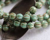 TURQUOISE MELONS .. New 25 Picasso Czech Melon Beads 6mm (5784-st)