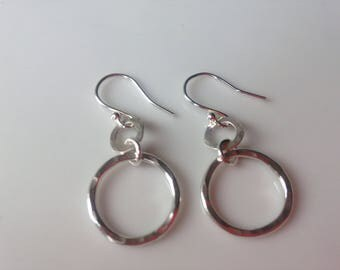 Silver hammered drop earrings .