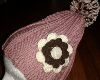 Hand Knitted Raspberry color Hat with multi color pompom and beige and brown flower, fits age 6 to Adult