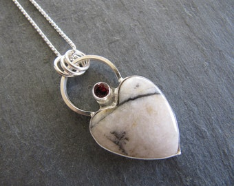 Pendant of White Buffalo Turquoise, Garnet, and Sterling Silver