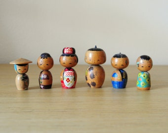 set of six tiny japanese kokeshi nodder dolls