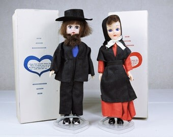 Vintage Amish Dolls Man and Woman with original box, stands and paperwork