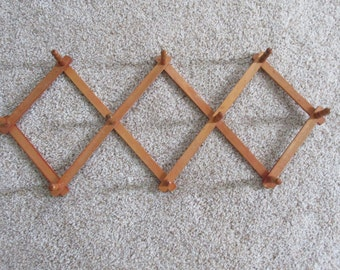 Accordion Wood Peg Rack in Natural Wood Color
