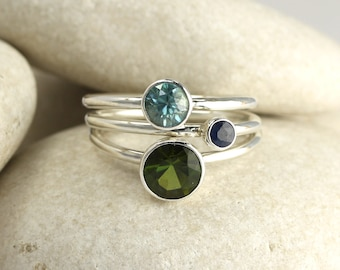 3 stacking rings in simple sterling silver bands with custom gemstones