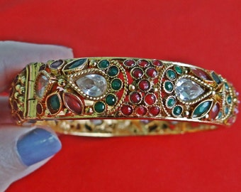"STUNNING Vintage gold tone hinged bangle bracelet with red green and clear rhinestones  in great condition, opening 2.5"", old school clasp"