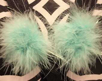 A Pair of Marabou Feather Puff Hair Clips With No-Slip Grips Aqua