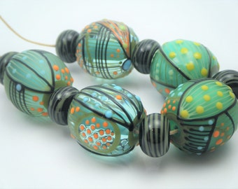 Moogin Beads- Detailed abstract round , lampwork / glass bead set   - SRA