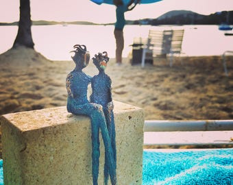 Little wild hair bronze figurines. They had so much fun at the beach and the beach club too. Honeymoon gift for her.
