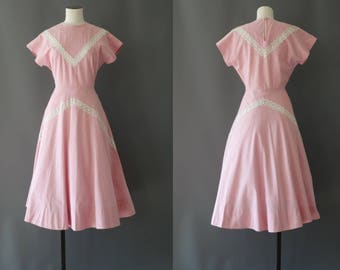 Vogue dress | candy pink cotton with eyelet lace details | 1950 by cubevintage | small