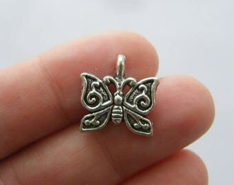 8 Butterfly charms antique silver tone A511