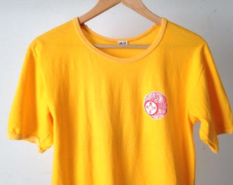 vintage 80s yellow t-shirt KL 1983 scoop neck unique dragon label red and white tshirt