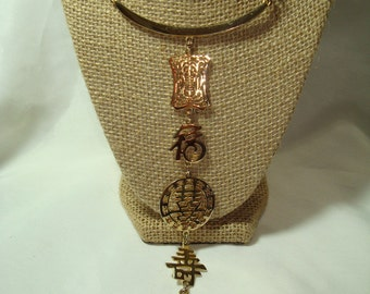 1980s Long Golden Tiered Chinese Asian Symbols Necklace.