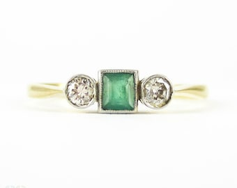 Emerald & Diamond Three Stone Engagement Ring, Bezel Set Square Cut Emerald and Round Diamonds. Circa 1930s, 18ct Plat.