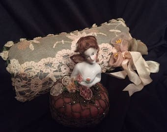 x Half Doll brunette with wig and tilted angular jaw on silk and bullion pin cushion skirt (FFs1037)