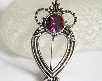 Vintage Scottish brooch.  Celtic style brooch.  Purple crystal brooch