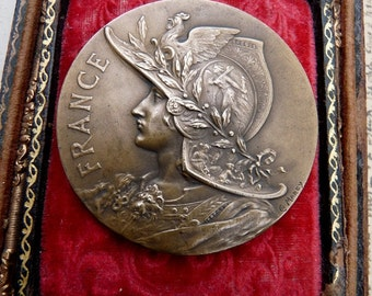 Antique French Warrior Woman Military Medal, Lady Liberty, offered by RusticGypsyCreations