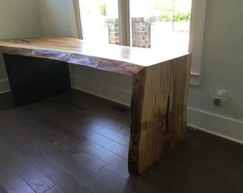 Waterfall edge desk in ambrosia maple and steel base