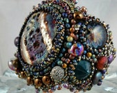 SPACE JAM  MAKU raku futuristic,bohemian, and textured bead embroidery wearable art cuff  borosilicate glass