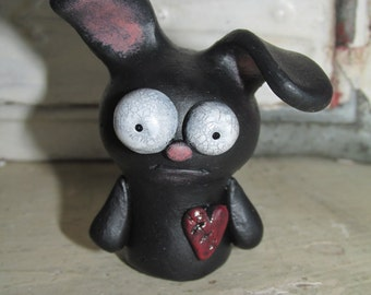 Mini Valentines black bunny with stitched heart sad sculpted original art by Janell Berryman Pumpkinseeds