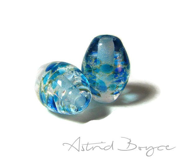 Frozen Ovals Artisan Lampwork Bead Pair - Capri Blue Glass paired with fine Italian Silver  -  these pair perfectly with 2mm Natural Leather