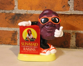 Vintage 80s 1987 CALIFORNIA Raisin Sun-Maid Raisins Orange Sunglasses Thumbs Up Plastic Coin Money Bank