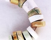 It is enough -- a set of 12 green, white and gold small ceramic beads