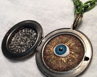 An Enchanted Triffer Eye. Magical Charm and Locket.