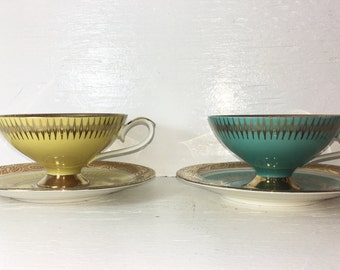 Set turquoise and yellow w Gold teacups and saucers his and hers mid century