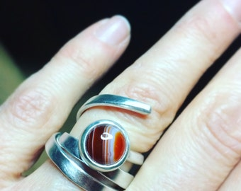 Coiled silver wire ring set with banded carnelian